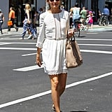 Olivia kept her daytime look demure in a white frock, feminine flats, and a trusty tan handbag.