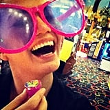 Chrissy sported a pair of giant sunglasses while at an arcade. Source: Instagram user chrissy_teigen