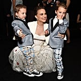 The dress was so flowy, she was even able to bend down to hug her two little costars Aiden and Brody Weinberg.