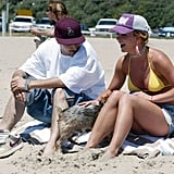 With a big smile on her face, Britney doted on her dog as she took in views off the Malibu, CA, coast in April 2004.