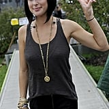 Sarah Barthel from Phantogram accessorized her tank and skinny jeans with stacked gold bangles and a pendant necklace.