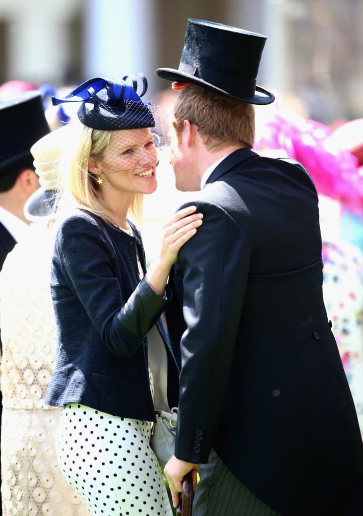 Prince Harry made his Royal Ascot debut on Tuesday, when he arrived on the first day of races alongside his grandmother Queen Elizabeth II, Prince Philip, and his uncle Prince Andrew. After the royal procession, Harry mingled with his friends and other family members, including Princess Beatrice, Princess Eugenie, and Zara Phillips. Like a good royal, Harry made a point of tipping his hat every time he greeted someone, including a pretty blonde who was talking with Beatrice, Eugenie, and their friends. (We all know that Harry loves blondes.) Perhaps Harry's appearance at the famed horse-racing event was a way to make up for missing Monday's Garter Service, which was attended by the Duke and Duchess of Cambridge and most of the senior royals. Because Harry is not (yet) a member of the Order of the Garter, he had no real reason to attend the event. However, Harry was on hand to give Kate Middleton a case of the giggles on Saturday, when he attended Trooping the Colour alongside his family. On Sunday, he helped his big brother celebrate his first-ever Father's Day during a charity polo match.