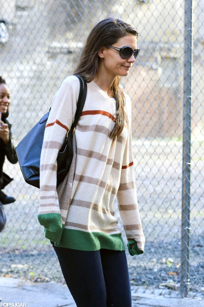Katie Holmes wore sunglasses and a striped shirt.