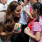 Kate graciously accepted a gift from a little girl during her September 2012 trip to Singapore.