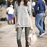 Looking pulled together can still be comfy, as evidenced by this sweater and skinnies combo.