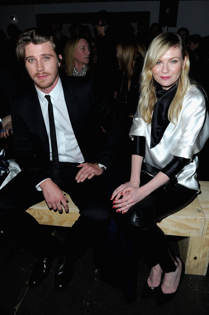 While sitting front row at Saint Laurent with boyfriend Garrett Hedlund, Kirsten showed off a silky black-and-white Rodarte blouse and black leather pants.