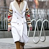 With a Geometric Printed Sweater Jacket and Black Heels