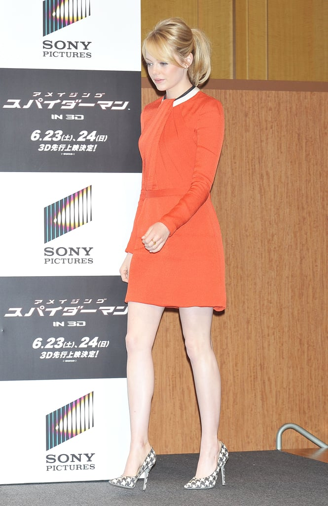 Emma Stone strode across the stage at the press conference for The Amazing Spider-Man in Japan.