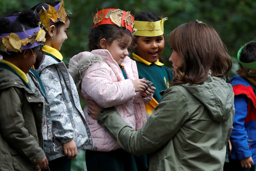 Kate geared up to hug this adorable young fan goodbye after visiting a school in October 2018.