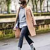 In Chic, Muted Shades With a Camel Coat, a Grey Polo Neck, and Boots