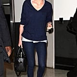 Preppy girls whose closets are stocked with classics will love Charlize Theron's airport outfit. She skipped anything overly trendy or loud in favor of dark denim, a v-neck navy sweater, and flats. So simple, but so chic!