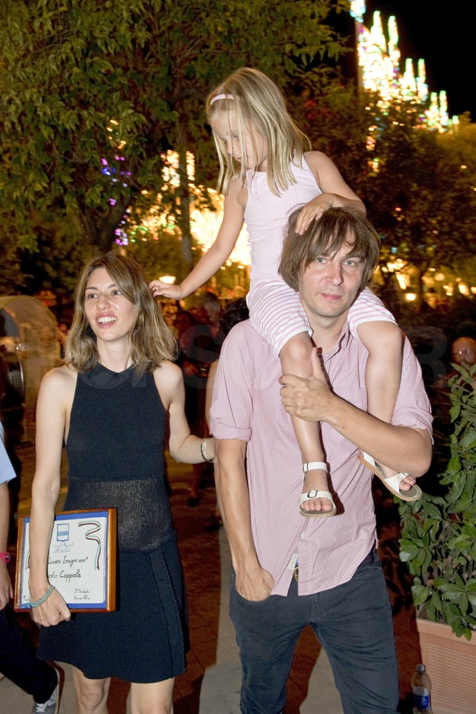 Romy Mars reached for her mom, Sofia Coppola, as Thomas Mars carried her on her shoulders.