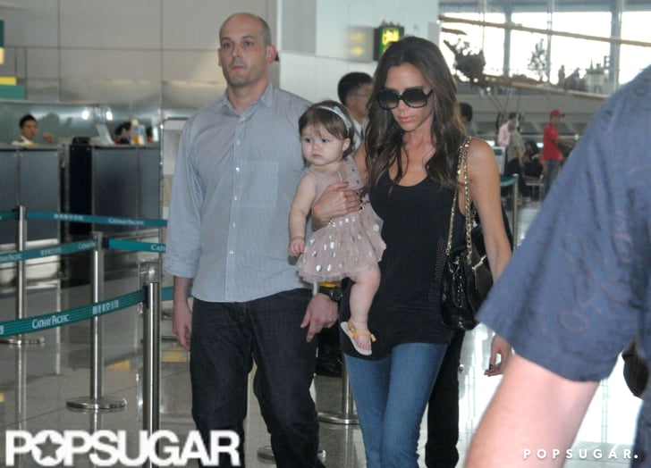 Victoria Beckham and daughter Harper Beckham prepped to leave Hong Kong.