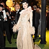 Dita Von Teese Wore a Gold Elie Saab Gown With Feathered Sleeves and a Giant Bow