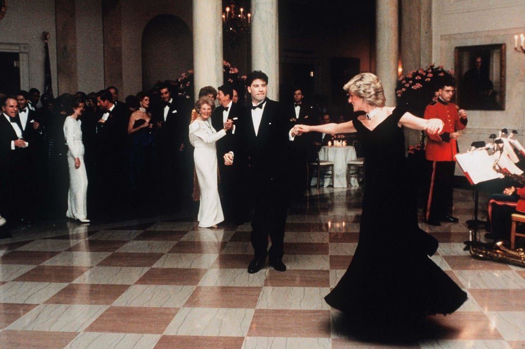 "An iconic Princess Diana dress is being given another whirl. After acquiring the late royal's velvet Victor Edelstein gown for about $280,000 at an auction last year, Historic Royal Palaces announced plans to put it on display at Kensington Palace upon its reopening on July 30.  Also referred to as the ""Travolta Dress,"" Diana first wore the midnight-blue dress to a White House gala in 1985, where she danced to songs from Saturday Night Fever with John Travolta. At the time, she accessorised the off-the-shoulder Edwardian dress with an ornate pearl choker and sapphire earrings. Diana wore the dress again to the premiere of Wall Street in 1988.  The dress's exciting exhibition will kick off Kensington Palace's reopening, as the royal residence was forced to close its doors in March due to the ongoing coronavirus pandemic. Visitors of the museum will be expected to book tickets for a specific time slot in advance, and there will be reduced capacity to protect the health of staff and visitors.  ""Kensington Palace was built to be enjoyed by hundreds of people and it's been sad to see it so quiet over the past couple of months,"" Head of Kensington Palace Sam Owen said in a press statement. ""Myself and the team can't wait to welcome visitors back again and give them a suitably royal welcome.""  See photos of the Princess of Wales wearing the dress on two separate occasions ahead, and enjoy a video of it being unpacked and installed for the display.  Related: Princess Diana Was the Ultimate '80s Style Icon, and These Pics Are Proof"