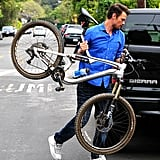 Josh Duhamel picked up his bike before heading to the baby shower.