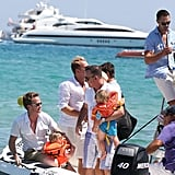 Neil Patrick Harris, David Burtka, Elton John, David Furnish, and their kids boarded a boat.