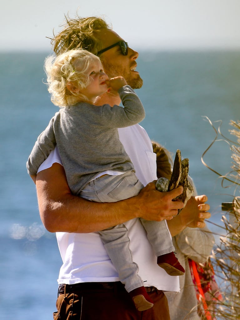 Eric Johnson carried Maxwell to the beach.