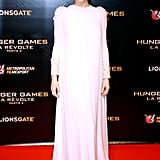 Jen turned to her inner boho queen when she walked The Hunger Games: Mockingjay Part 2 red carpet in Paris. Her Dior Couture white dress was made of chiffon and featured fur sleeves. Jen's outfit was finished with jewels by Shay Jewelry and Dana Rebecca, and she wore Sophia Webster heels.