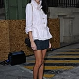 Caroline Sieber paired a tweedy white jacket with a gray miniskirt and black booties to attend Chanel.