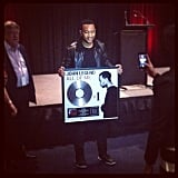"John Legend happily posed with his brand spankin' new plaque for hitting number one in Australia with his new single ""All of Me""."
