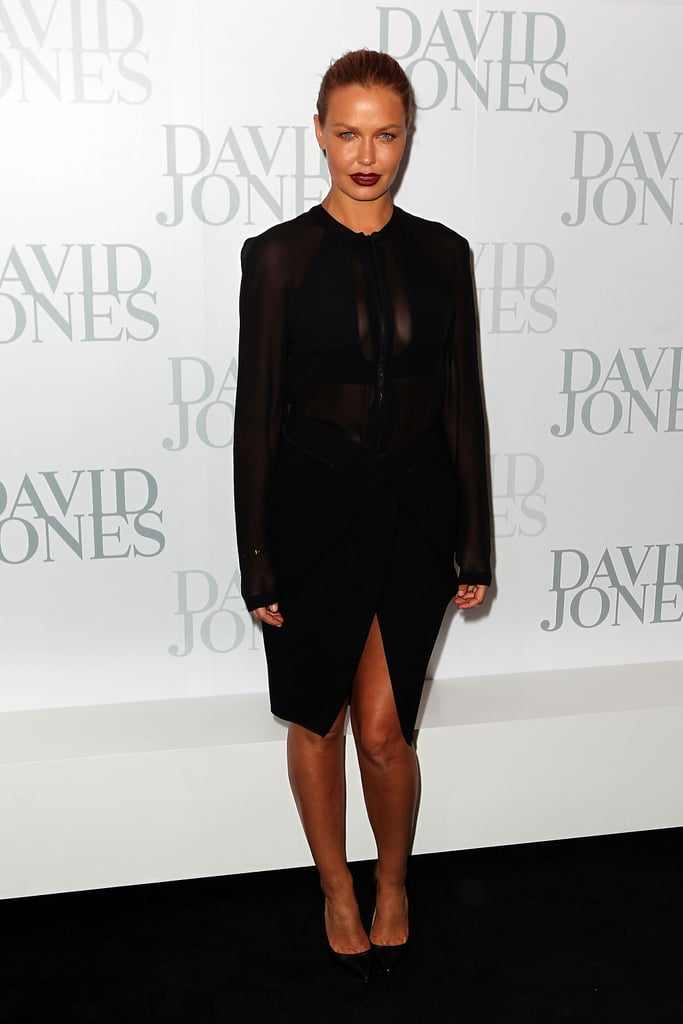A dark and dramatic Lara Bingle faced the media at the David Jones Spring/Summer 2013 Collection in Sydney on August 14.
