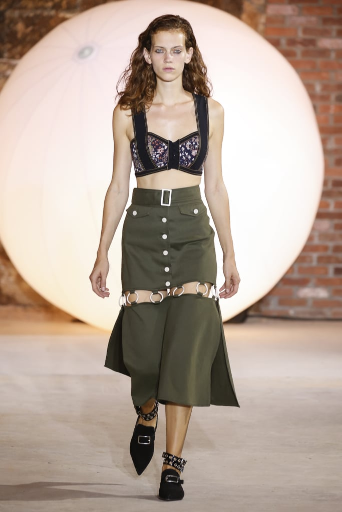 Her Fucntional Midi Skirts Are Broken Up With Grommets