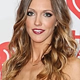 With her dark blush, bold lips, and shimmery smoky eyes, Katie Cassidy went all out in the makeup department.