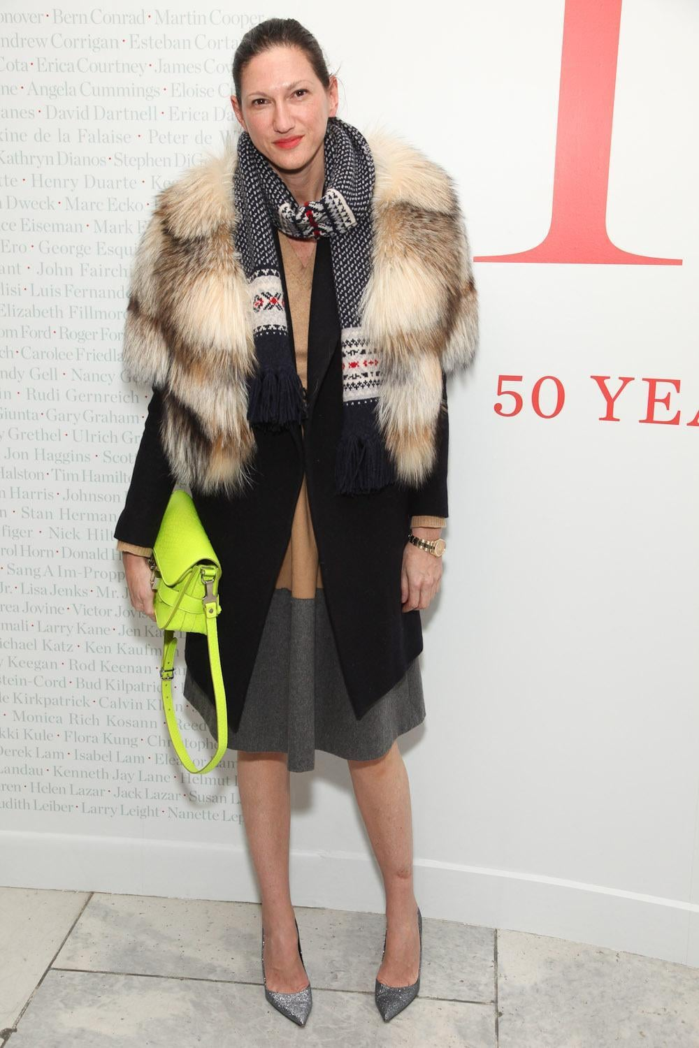 Fur and heels juxtaposed against a neon schoolboy satchel and knit scarf adds up to the sort of intrigue we've come to expect from the J.Crew chief.