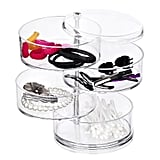 For more compact pieces (including hair accessories!), the Choice Fun Acrylic Jewelry and Accessories Organizer ($19) is a must-have. Each of the four stacked tiers swing out for easy access, but save tons of space when neatly lined up.