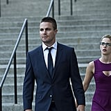 Stephen Amell as Oliver Queen and Emily Bett Rickards as Felicity Smoak.