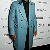 Idris Elba looked dashing in a blue coat at the Harper's Bazaar Women of the Year Awards.