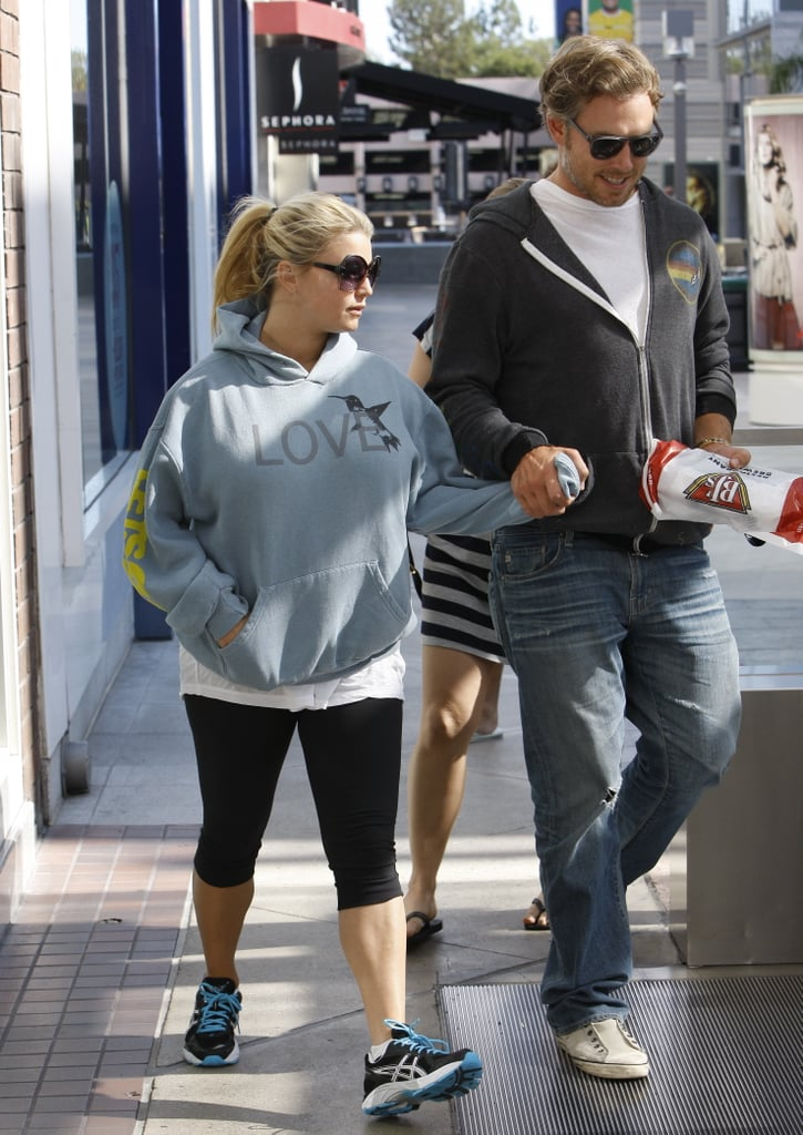 "Jessica Simpson held hands with her fiancé, Eric Johnson, yesterday when they went out to get sandwiches for lunch. Decked out in a sweatshirt that said ""love,"" Jessica hopped on an escalator with Eric and their subs from BJ's. Jessica's top was her latest in a long line of loose-fitting ones. The billowing garments have prompted a great deal of speculation that Jessica Simpson is pregnant, and it was recently reported that Jess is, in fact, eating for two. With child or not, Jessica has been busy with work. She and Eric are home in Southern California again after a weekend trip to San Francisco, where she debuted her new Jessica Simpson Collection at Macy's. Her next trip will be to New Orleans for another meet and greet with fans and shoppers on Oct. 8."