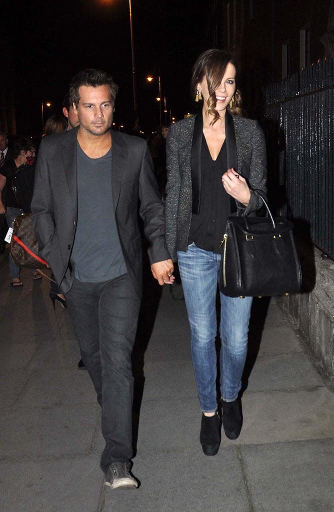 For a 2012 Dublin date night with husband Len Wiseman, Kate polished off her whiskered denim with a tweed tuxedo blazer, a luxe Alexander McQueen bowler bag, and gold tassel earrings.