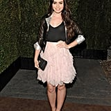 Lily Collins had a look similar to Rachel Bilson, with a dainty dress under a sharp jacket.