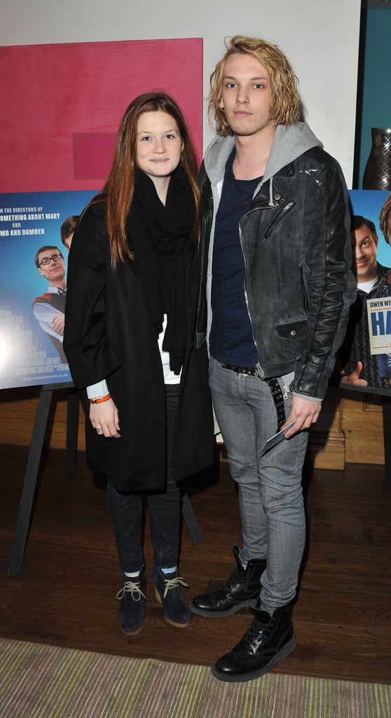 """Bonnie Wright and Jamie Campbell Bower cuddled close at a screening of Hall Pass in London last night. Stephen Merchant watched the movie too, which Buzz thought was an unfunny mess: will you see it or skip it? Jamie and Bonnie were dressed more casually than their last public appearance together at the BAFTAs, where they were one of the cute couples to walk the red carpet and attend the afterparties. Jamie was back on dry land following his recent surfing holiday. He's gearing up for the release of his new American TV series, Camelot, in which he stars as Arthur alongside a fab cast including Tamsin Egerton, Joseph Fiennes, and Eva Green. He recently tweeted: """"Thank you for all the love regarding sneak preview of Camelot last night. April 1st Starz. Be there."""""""