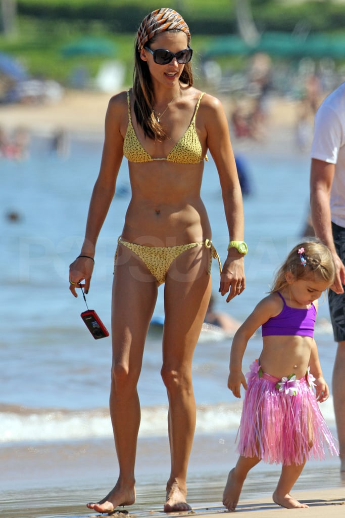 A bikini-clad Alessandra Ambrosio and her daughter, Anja, checked out the scene on the beach in Maui yesterday. Anja wore an adorable hula skirt with her two-piece, though Alessandra made sure to put her little one in a life jacket when it was time to hit the waves. The girls are joined by Alessandra's boyfriend Jamie Mazur for the Hawaiian vacation, which is just the trio's latest getaway in a busy Summer of work and play. All the amazing Alessandra swimsuit pictures over the past year helped earn her a top 10 spot in our 2011 bikini competition — check out where all the gorgeous women placed with our official PopSugar Bikini Bracket standings!