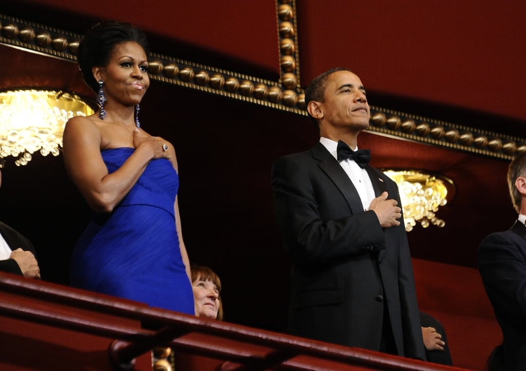 President Barack Obama and First Lady Michelle Obama held their hands over their hearts.