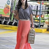 Jordana Brewster picked up groceries in a pretty coral pleated maxi skirt.