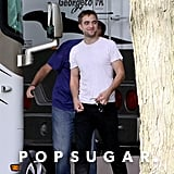 Robert Pattinson was all smiles as he reported to work the set of his film, Maps to the Stars, in Toronto, Canada.