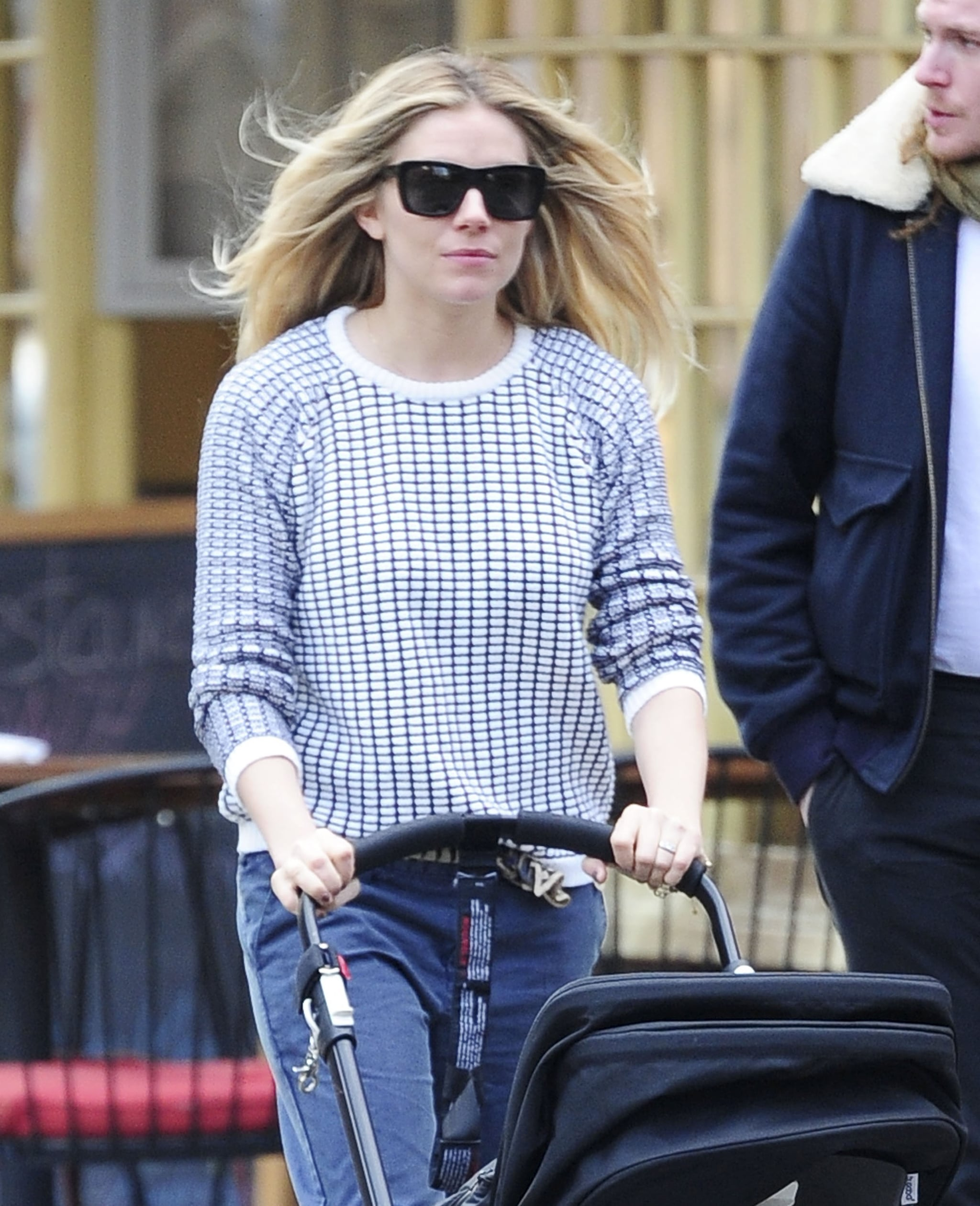Sienna Miller wore sunglasses and a sweater while getting fresh air in NYC.