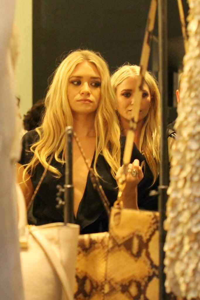 A peek at the Olsen sisters at a Paris Fashion Week party.