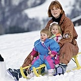 The young princesses were cuddled by their mom during a toboggan ride in 1992.