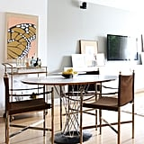 The apartment's look thoughtfully transitions from art deco to midcentury in the dining area.