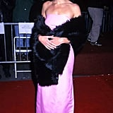Julia worked a strapless, pink floor-length gown with a furry stole to the Stepmom premiere in 1999.