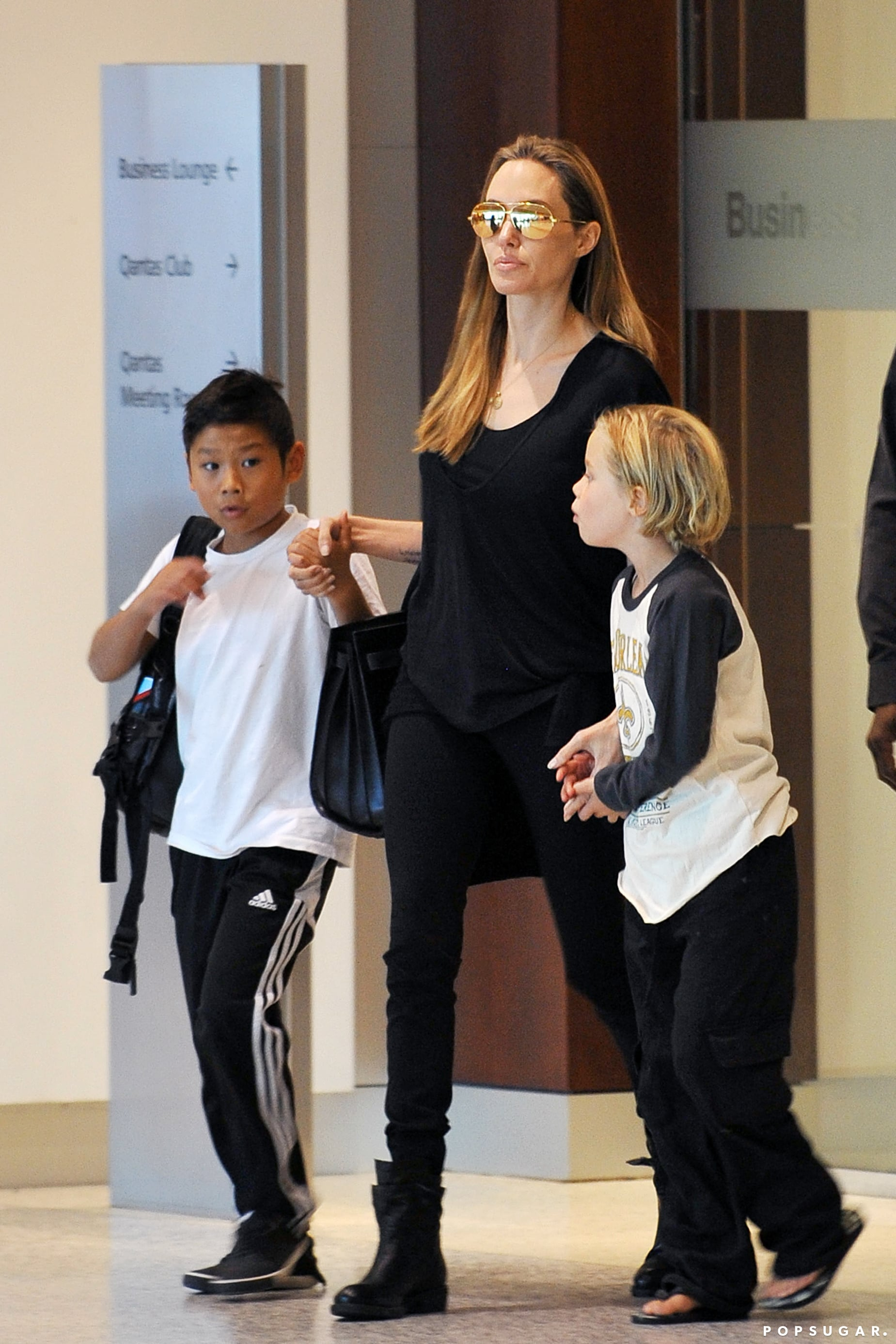 Angelina Jolie held Shiloh's and Pax's hands as they departed the airport in Sydney.