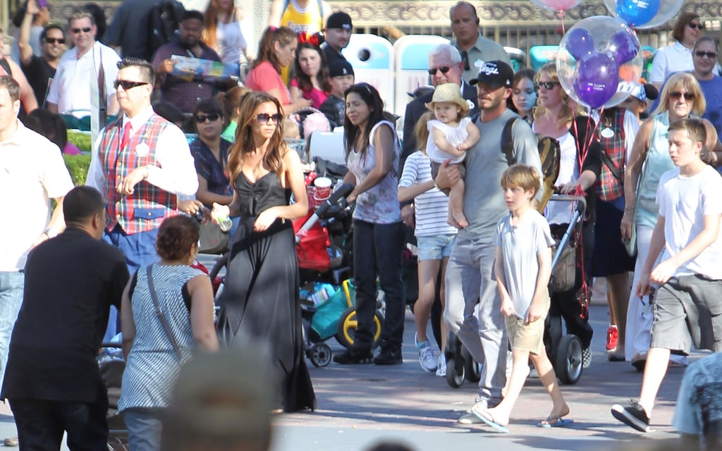 Victoria Beckham and David Beckham led their gang around Disneyland.