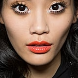 This tangerine lipstick from the Moschino Spring 2013 runway was the most pinned among all our favorite orange makeup ideas.