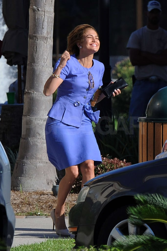 "Jennifer Lopez was in a celebratory mood on the set of Parker in New Orleans yesterday. The action movie also stars Jason Statham, and during her evening of work, Jennifer's character flirted her way out of a ticket from a police officer. The star is focusing on her kids, Max and Emme, and her career in the wake of her recent split from Marc Anthony. She filmed her role in What to Expect When You're Expecting in Atlanta in July and August, then was in downtown LA late last month to shoot her ""Papi"" music video. Jennifer opened up about the breakup in Vanity Fair shortly after announcing their decision to divorce, and Marc has also spoken out about the end of their marriage. Jennifer may be weathering some tough times in her personal life. but her career is on the uptick. Not only is she enjoying her return to big-budget, big-screen projects, but she reportedly negotiated a $20 million contract when she solidified her deal to return to American Idol for a second season."