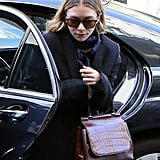Ashley wore yellow tinted shades with an oxblood bag in Paris in 2014.